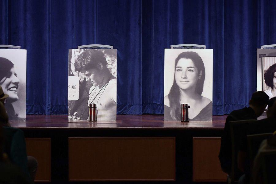 Photographs of the four students killed on May 4, 1970, sit on the stage in the Kent Student Center Ballroom during the 48th annual May 4 Commemoration.