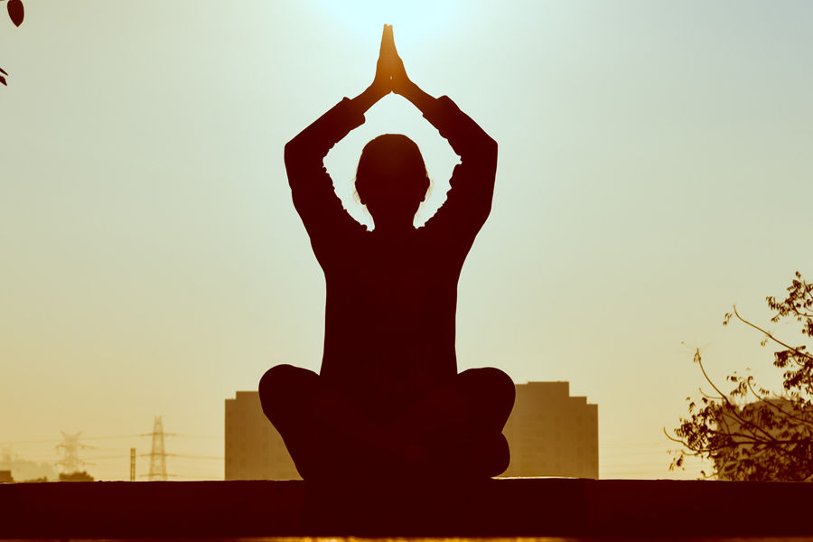 Silhouette of person meditating