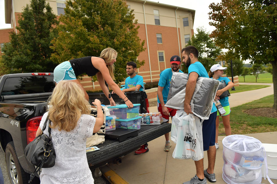 Kent State University volunteers help move freshman into their new residence halls during the annual service program, called Movers and Groovers.