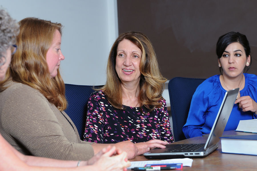 Kent State Associate Professor Denice Sheehan meets with her research group in Henderson Hall. Sheehan has been selected as Kent State's Scholar of the Month.