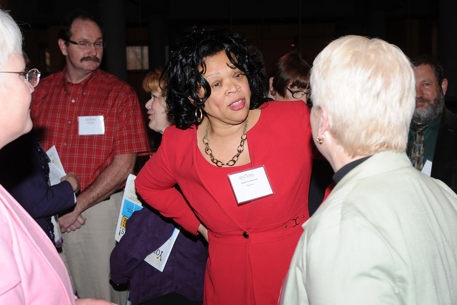 Angela Neal-Barnett, Ph.D., a professor and researcher in the Department of Psychological Sciences, talks with fellow faculty members during a Faculty Appreciation Week event in 2014.