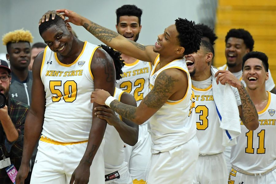 Kent State men's basketball players congratulate freshman Kalin Bennett (left) for playing in his first college basketball game. Bennett is the first true freshman diagnosed with autism to sign a letter of intent in Division I men's basketball.