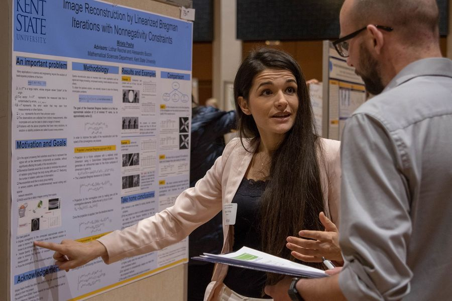 A Kent State University graduate student presents her research at the university's annual Graduate Research Symposium.