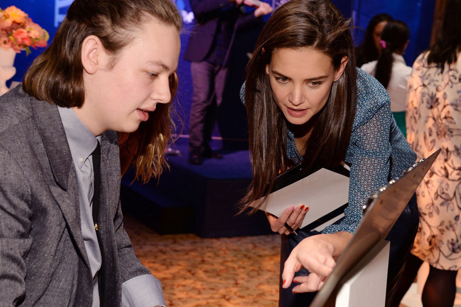 Actress Katie Holmes, who served as a judge, reviews a Kent State student's work. (Photo by Patrick McMullen, courtesy of JC Penney.)