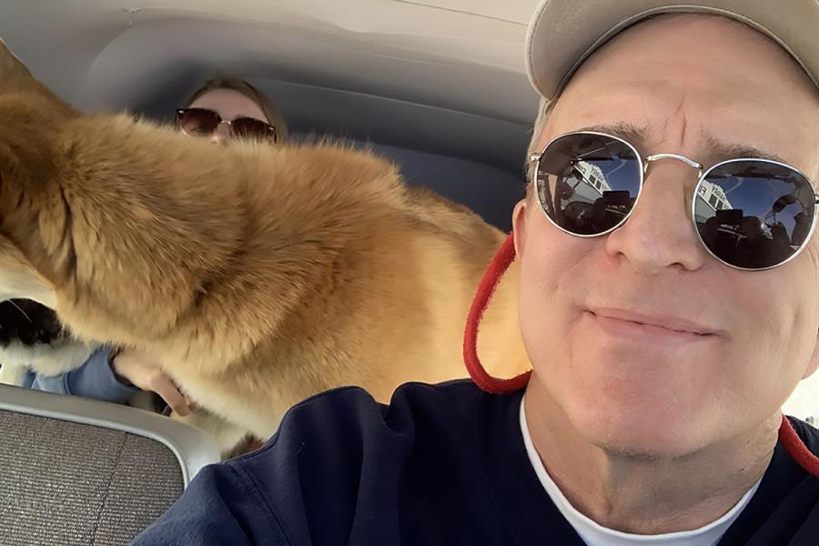 Professor Joe Murray flies a plane with a dog behind him