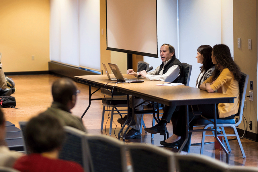 """Journalist Daniel Grossman answers a question during the Spring 2018 Pulitzer Center on Crisis Reporting panel discussion, """"Advancing Understanding of Climate Change: The Role of Science and Global Communication."""""""