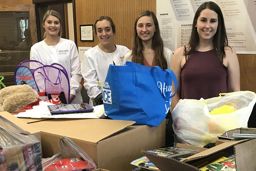 Kent State Trumbull nursing students collected toys and books for children at the Rescue Mission of the Mahoning Valley. Pictured left to right are students Valerie Salyers, Taylor Stull, Megan Woolfrom and Kayelan Nyako.