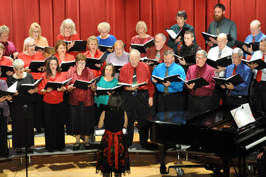 Director Melissa Fucci leads members of the Kent State Salem Communiversity Choir at during its annual holiday concert.