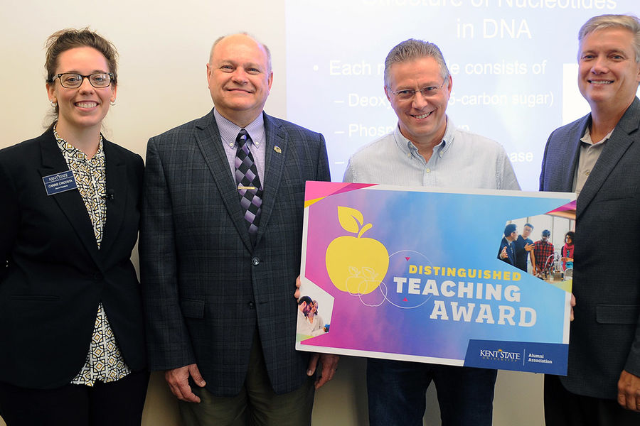 Kent State University Associate Professor Donald Gerbig is shown with his Distinguished Teaching Award.
