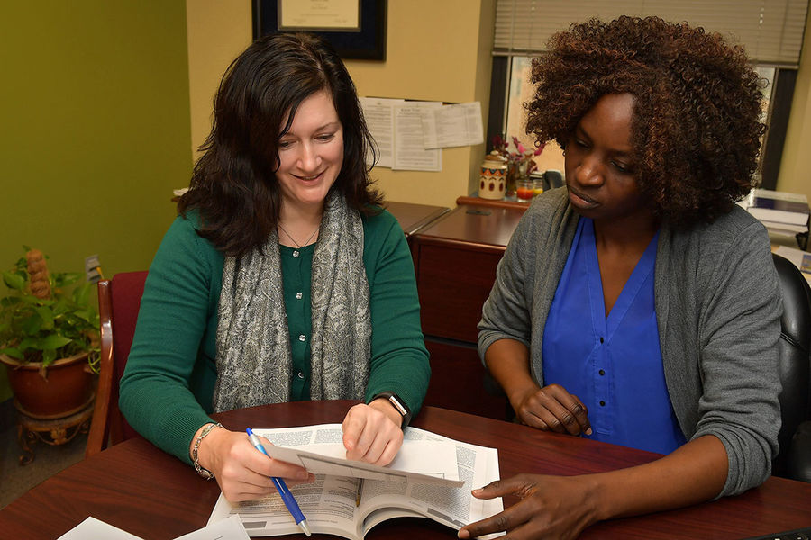 Melissa Zullo (left), associate professor of epidemiology in Kent State's College of Public Health, works with a Ph.D. student.
