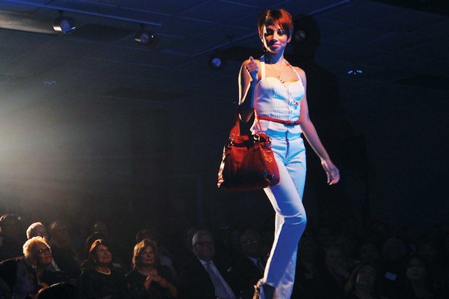A model walks the runway at one of the Fashion School