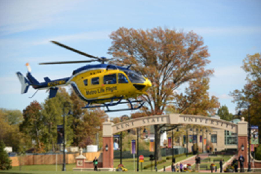 Metro Life Flight landing near the Kent State arch on front campus