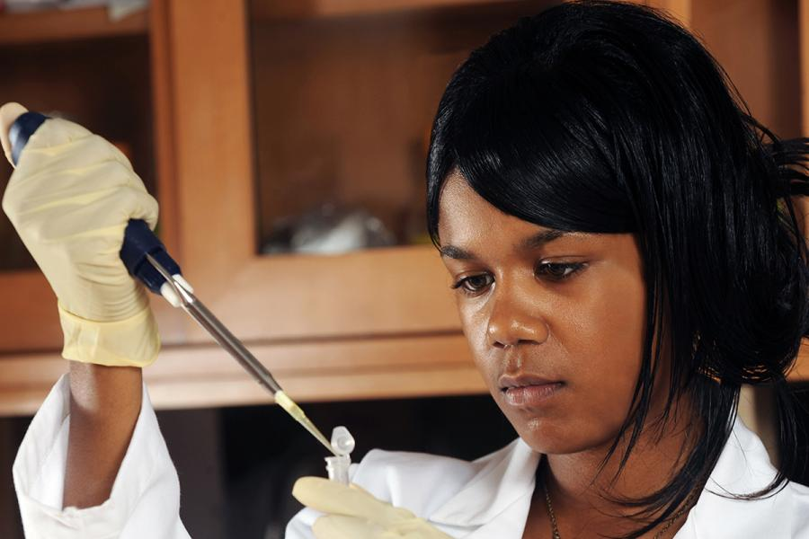 A Kent State student researcher conducts an experiment in a science lab on the Kent Campus.