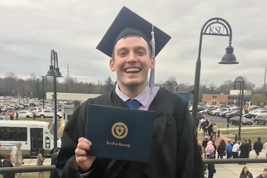 Kent State graduate Garrett Holubeck overcame cancer to earn his degree.
