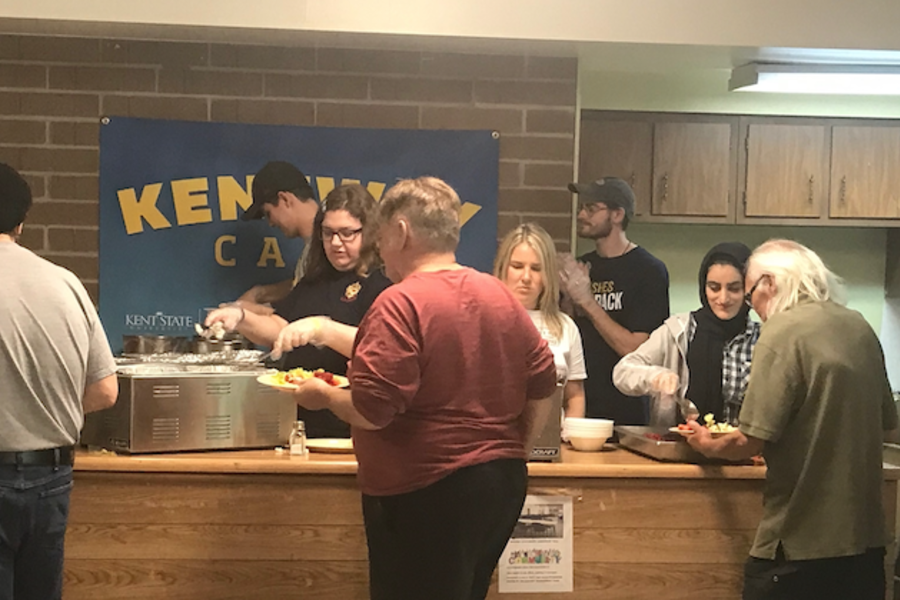 Kent State volunteers serve home-cooked meals to Kentway residents.