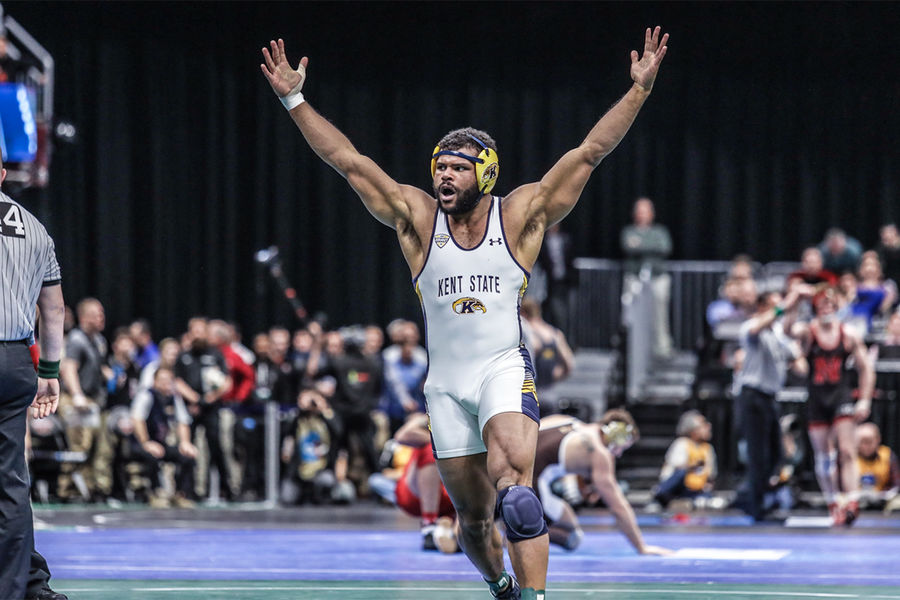 Kent State wrestler Kyle Conel celebrates after pinning No. 1 seed Kollin Moore of Ohio State at the 2018 NCAA Division I Wrestling Championship in Cleveland. (Photo credit: John Sachs)