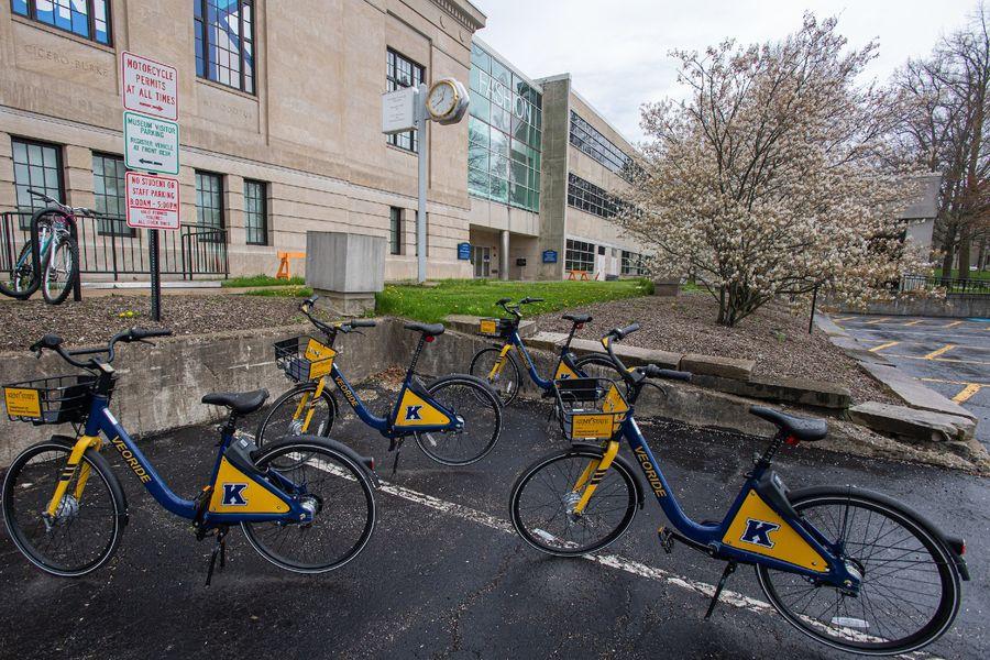 Four Kent State FlashFleet bikes sit in a parking lot on Kent Campus