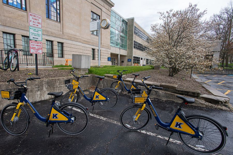 Four Kent State FlashFleet bikes sit in a parking lot on Kent Campus