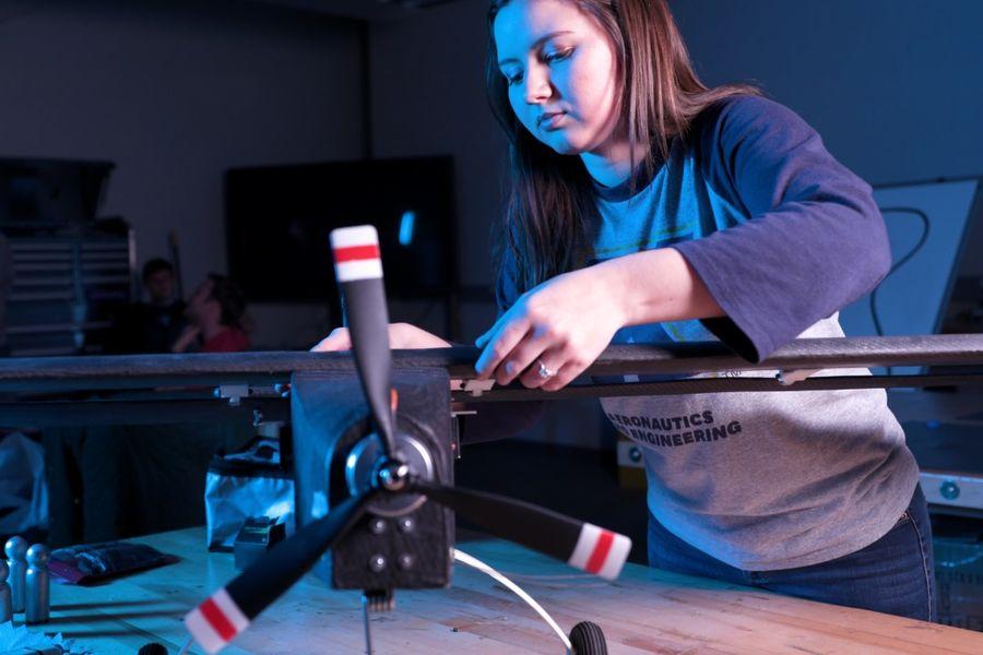 Female student in aeronautics lab