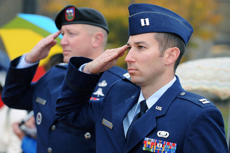 Members of the Kent State Air Force ROTC detachment salute as the American flag is raised during the annual Veteran's Day ceremony on the Risman Plaza.