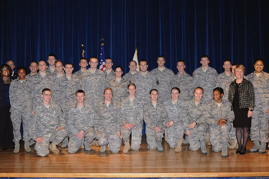 Kent State Army and Air Force ROTC cadets and university officials pose for a photo with Kent State President Beverly Warren in the Kent Student Center Kiva following the 2015 Kent State Veterans Day observance.