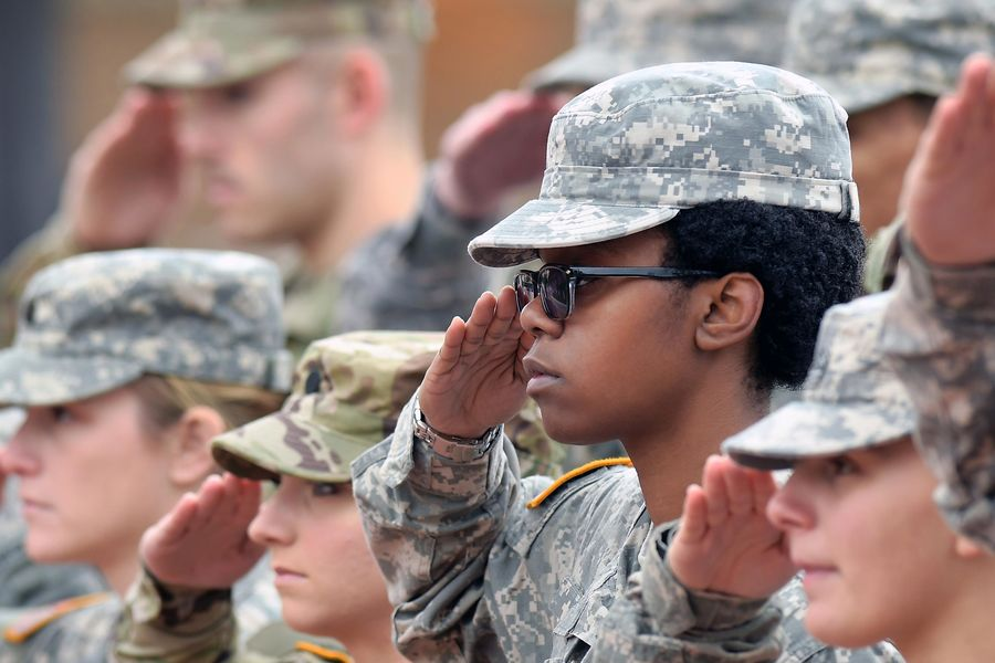 Kent State ROTC cadets salute and stand at attention during the flag-raising ceremony at Risman Plaza.