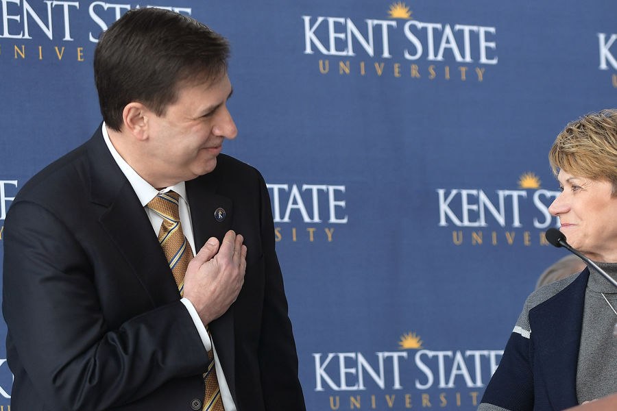 Kent State President Beverly J. Warren acknowledges the new director of the university