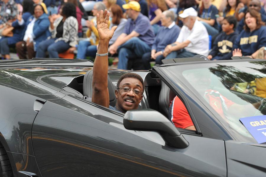 Fox8 News Anchor Wayne Dawson waves at the crowd during the 2018 Homecoming parade