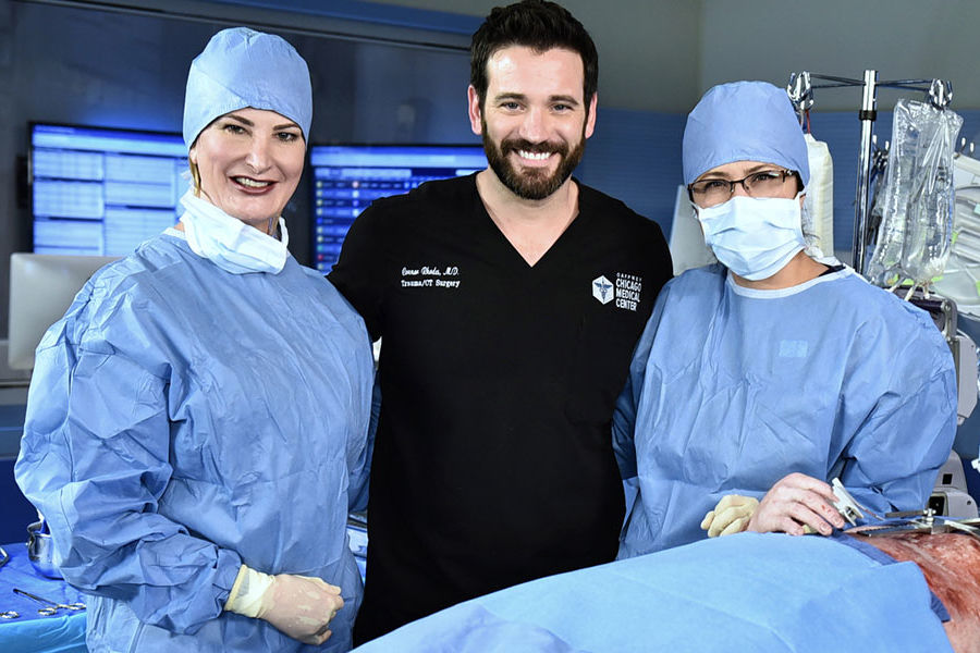 Erin Shelley (left) with Chicago Med star Colin Donnell (middle) and RN technical expert Sophia Meneses (right)