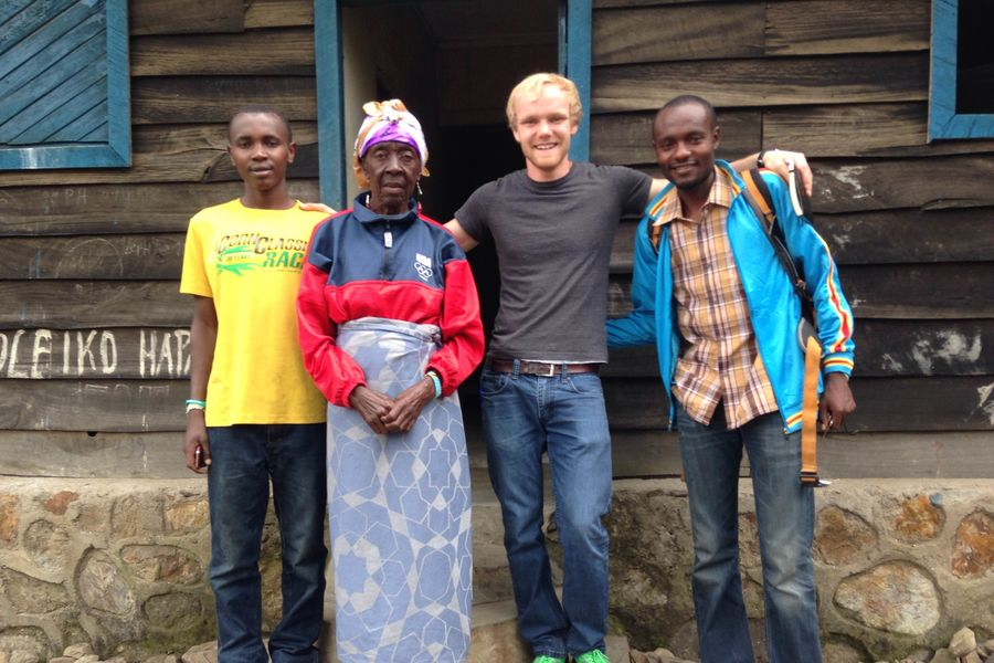 image of daniel socha posing with individuals involved with project kirotshe