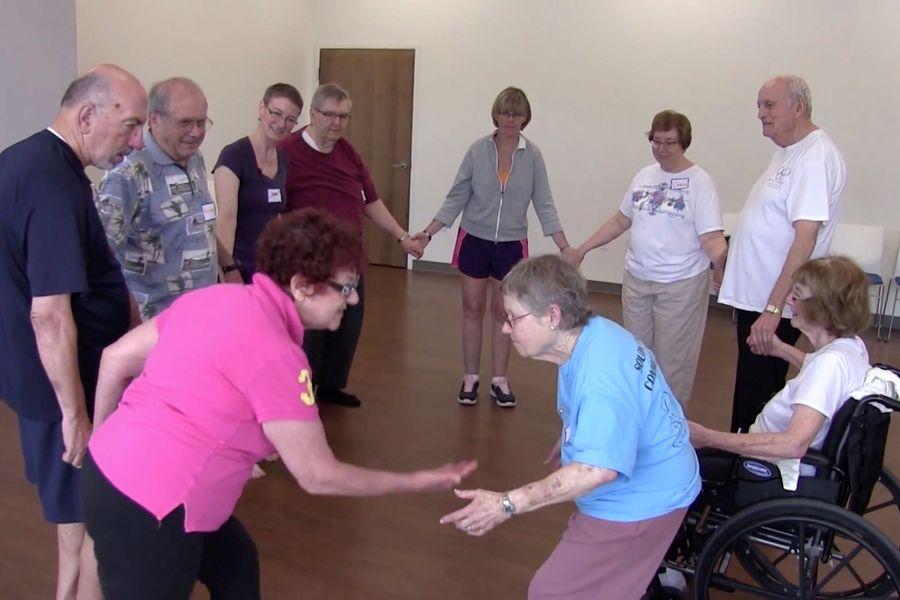 Associate Professor of Dance Joan Meggitt teachers a class for Parkinson's disease sufferers.