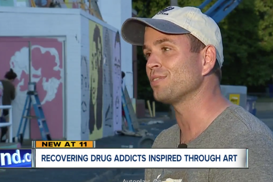 Christopher Darling created a program to paint murals on the Oriana House Hough Building as part of a revitalization project.