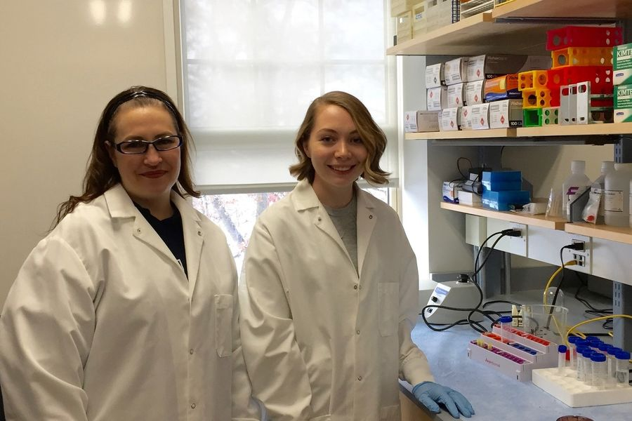 ASM undergrad fellow Gerbig and Dr. Smith test for Staphylococcus in the lab
