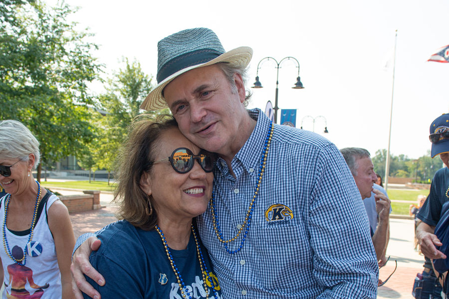 Kent State President Todd Diacon and his wife, Moema Furtado, embrace during the Kiss on the K event during Kent State
