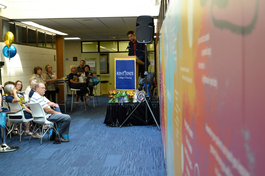 David Hassler, director of the Kent State University Wick Poetry Center, unveils