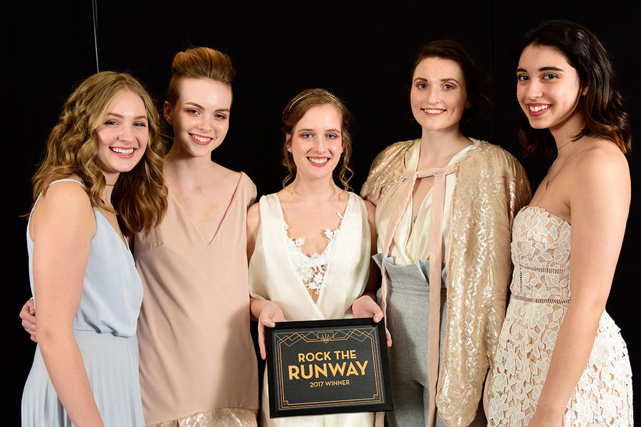The winning models and designers of Rock the Runway 2017 pose for a picture with their plaque.
