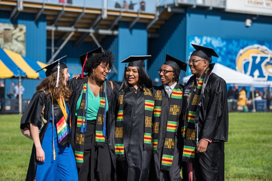 Students pose for a photo after a commencement ceremony.
