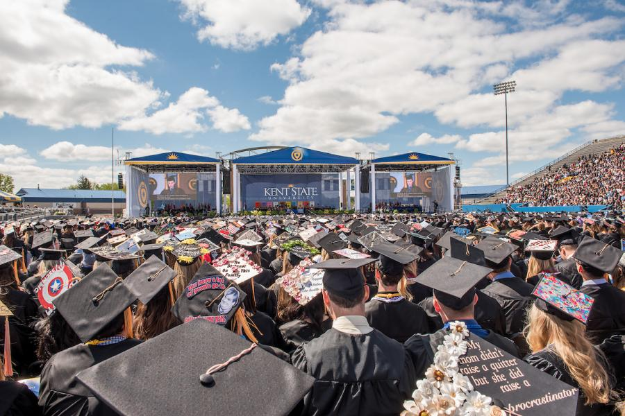 Kent State graduates attend a commencement ceremony at Dix Stadium in 2019.