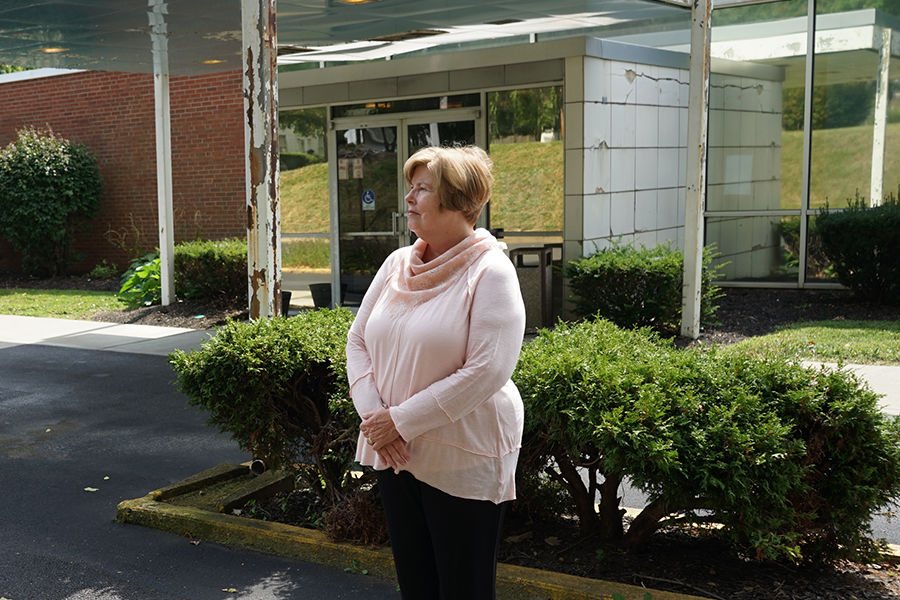 Pat Gless reflects on May 4, 1970 near what was then the ambulance bay of the old Ravenna hospital