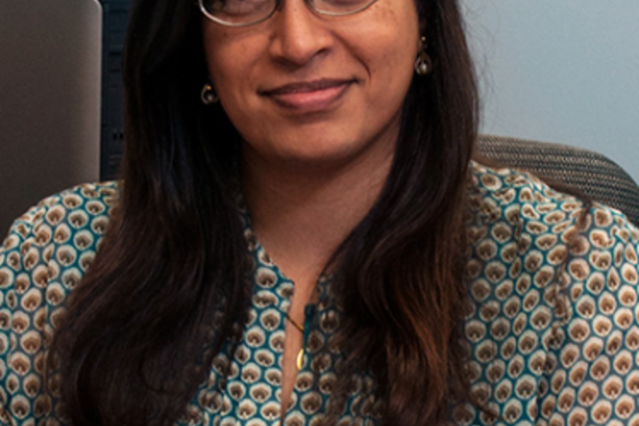 Rekha Sharma sitting with hands crossed