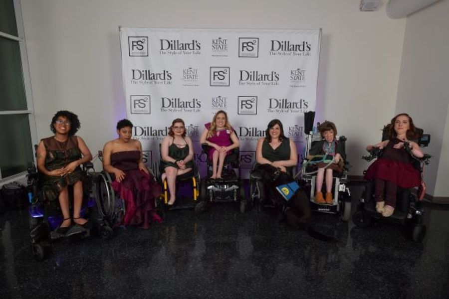 Kaycee Marshall, center, and her models show off the collection of formal wear she created for women in wheelchairs.