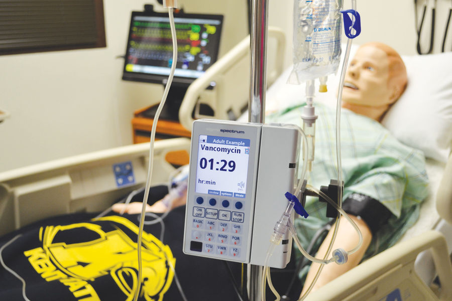 A smart-pump IV is shown giving a dose of high-risk IV medication to a 3G manikin in the Olga A. Mural Simulation Lab in Henderson Hall at Kent State University.