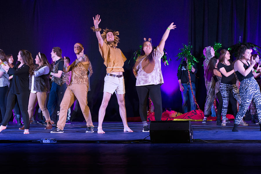 """Members of Alpha Sigma Phi, Alpha Tau Omega, Alpha Xi Delta and Phi Iota Alpha act out their """"Lion King"""" skit during Songfest, Fraternity and Sorority Life's annual philanthropic event. (Photos courtesy of Signum Design)"""