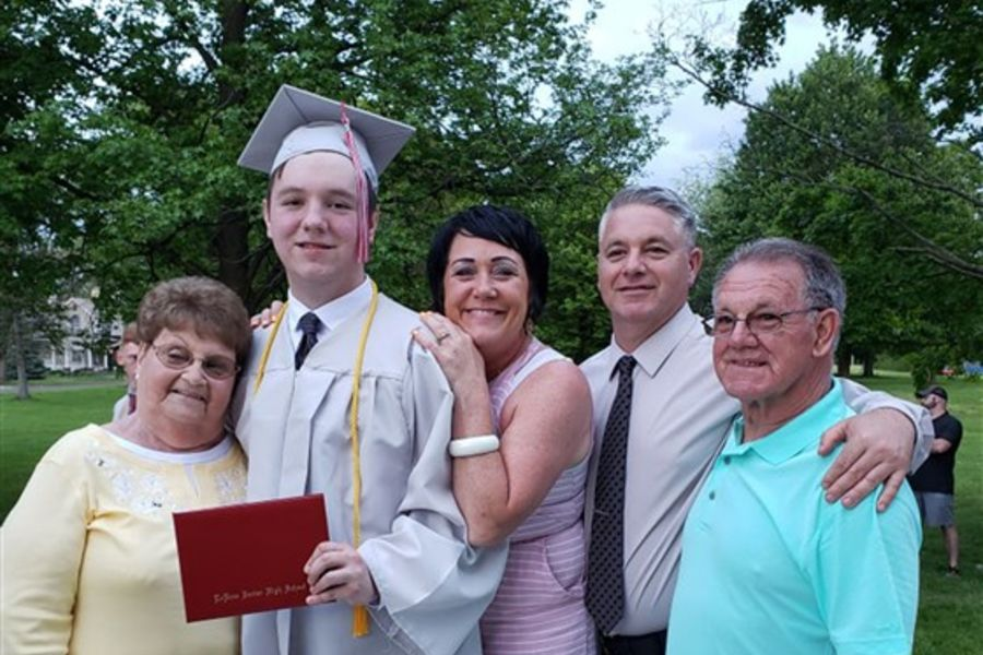 Tanner Noble celebrates his high school graduation with his family.