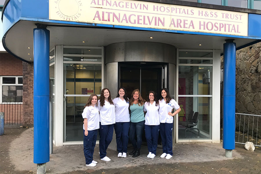Left: Students pose in front of the Altnagelvin Area Hospital in Northern Ireland. Right: Students studying in Florence, Italy stop for a photo with Dr. George Benaim at Poggibonsi Public Hospital in Poggibonsi, Italy.