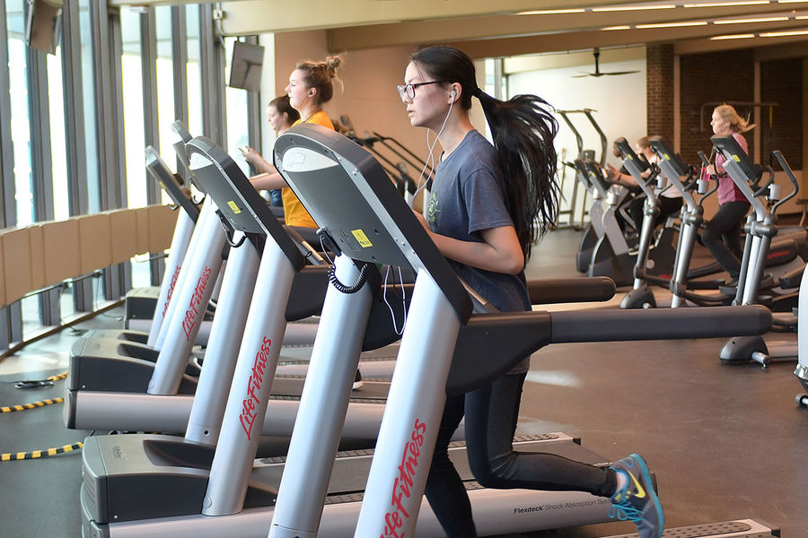 Kent State students work out in the university's new Tri-Rec fitness facility located in the Tri-Towers Rotunda.