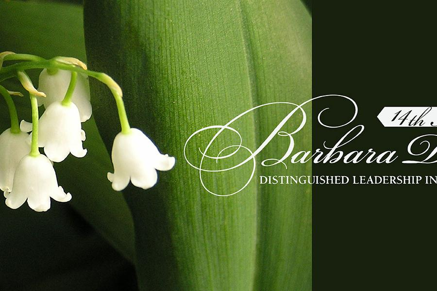 Lily of the valley flowers behind the Barbara Donaho Distinguish Leadership in Learning Awards logo