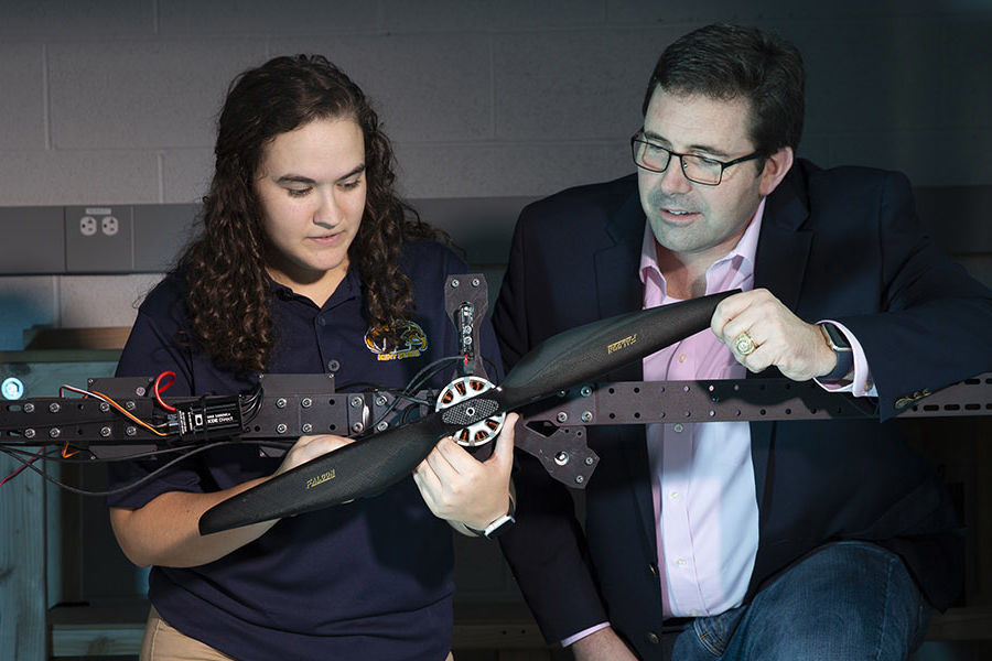 Blake Stringer, Ph.D. (right), assistant professor of aerospace engineering at Kent State, and research assistant Kendy Edmonds study the power needs for a new larger generation of drones for a research grant funded by the Army Research Laboratory.