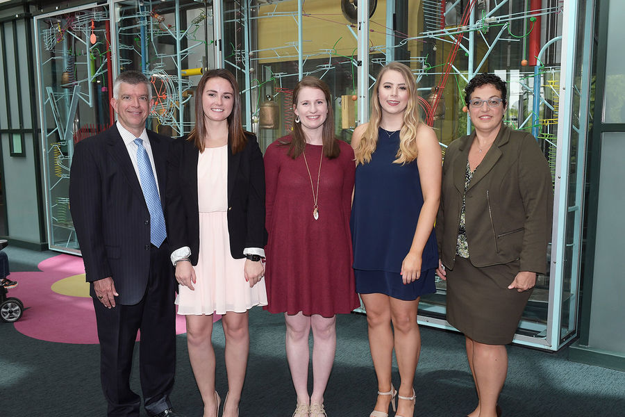 Victoria Harger, Caitlin Flynn, and Jess Paul stand with Akron Children's Hospital's Jeffrey Hord, MD, Director, Showers Family Center for Childhood Cancer and Lisa Aurilio, MSN, MBA, RN, NEA-BC, Vice President of Patient Services & Chief Nursing Officer