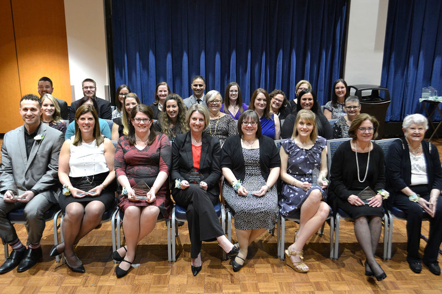 Barbara Donaho, far right front, sits with the 2018 recipients of the Barbara Donaho Distinguished Leadership in Learning Award.